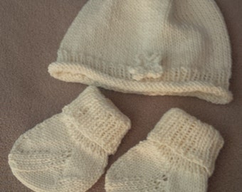 Rolled edge baby hat with knitted flower and matching socks
