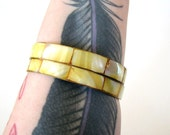 yellow shell inlay and brass bangle bracelet set of 2 . 1970s shell and brass bangles . vintage mother of pearl bangles mop