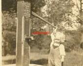 Little girl water pump outdoor farm overalls photo vernacular rural work labor