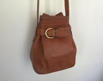 Classic COACH Leather Belted Bucket Bag in British Tan.