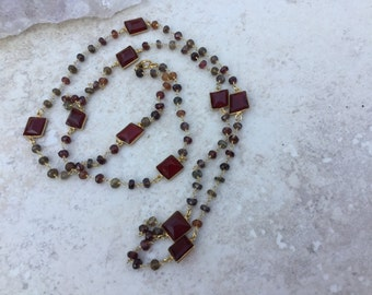 Long Layering Garnet and Tundra Sapphire and Gold Filled Wire Wrapped Necklace.