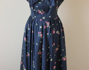 1950s navy blue floral dress with light pink chiffon pleated neckline