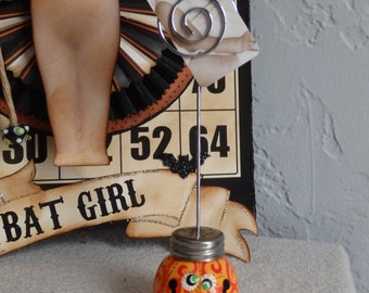 Photo Holder, Halloween Jack-O-Lantern Pumpkin with Green Eyes and Bright Orange Swirlies, by Stacy Marie
