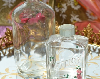 TWO VINTAGE BOTTLES, extraordinary large early glass bottles