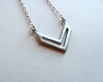 Silver chevron cutout pendant bib necklace on antiqued silver chain, geometric necklace