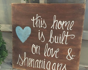 This home is built on love and shenanigans  wooden hand painted distressed wooden sign this house is built on love & shenanigans
