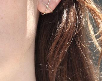 X Ear Huggers. Minimalist stud ear cuffs in sterling silver or 14k gold.