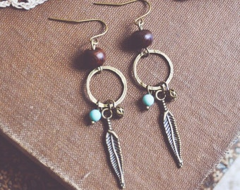 earthy feather earrings.