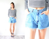 Vintage high waist cut of jean shorts // light blue jean shorts // daisy duke shorts // levi light blue blue jean shorts // festival shorts