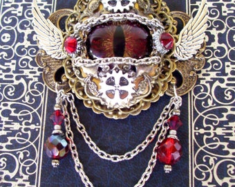 Dragon Eye Brooch (P605) - Dark Red Gold Glass Eye - Antique Brass Hardware - Crystal Dangles - Silver Wings - Pin Fastener with Bail Loops