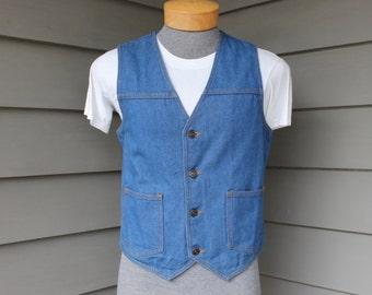 vintage 1970's -JC Penney- Men's denim vest. Possibly 'NeW'. Cinch back w/ sliding buckle. All cotton.  Medium