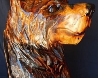 Black Bear Cub In a Stump Chainsaw Carving Sculpture