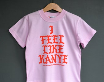 I Feel Like Kanye - Girls Kanye West T-shirt. Vivid red print on a cool Pink Tee. Yeezy hip hop tee for girls.