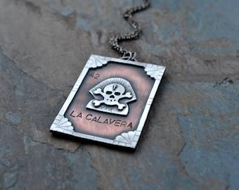 SALE. La Calavera necklace. Mexican Loteria. Loteria Card. #42 Skull Card. Mixed Metal. Mexican Bingo Unisex. Large Statement. Cross Bones