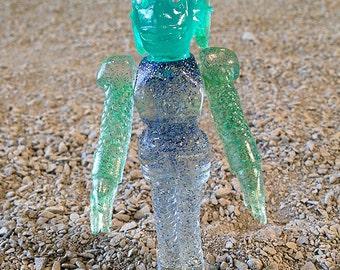 SEA-BORG MUTATION  Wave 2 Plastic Resin Figure - blue/green glitter
