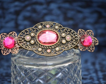Vintage fuchsia glass and brass barrette