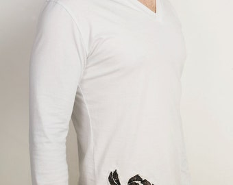 Minimalist asymmetrical white v neck t shirt with long sleeves and rose and crossbones applique
