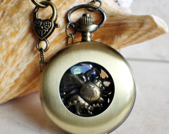 Bumble bee pocket watch case locket, filled with brass bumble bee and blue crystal elements.