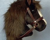 Hobby horse, stick horse, Dark Brown plush fur fabric. Top quality with hardwood pole and wheels and removable leather bridle with bell.