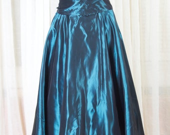 Teal taffeta circle skirt w/sash tie belt. 1970s