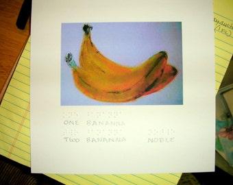 Una Banana due banane con scritte in Braille