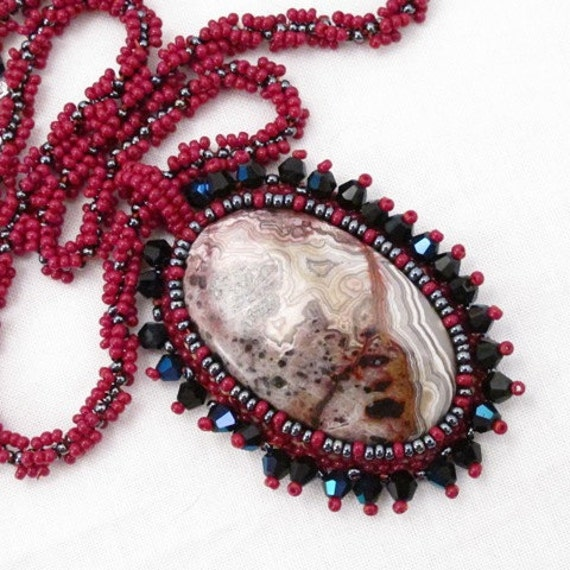 Necklace Crazy Lace Agate cab bead embroidered with rust and pewter seed beads, black crystals