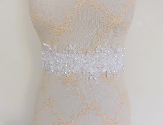 White sash decorated with floral lace and pearls. Wide sash. Bridal sash.