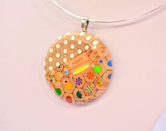 Ring pendant necklace from colored pencils