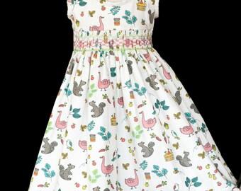 Hand-smocked needlecord cotton sleeveless pinafore dress, age 4 to 5, with animals, fruit and veggies on white background