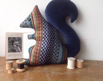 Squirrel shaped animal decorative pillow handmade using vintage fabrics in Brighton UK .