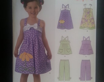 New Look 6973 Girls Summer Dress / Sundress, Top, Pants sewing pattern sizes 3-4-5-6-7-8