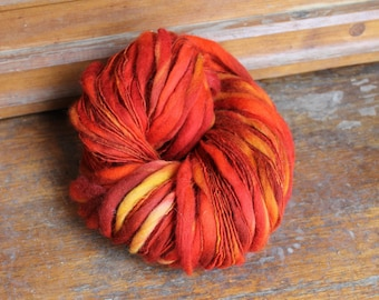 Phoenix feathers - handspun art yarn - thick and thin