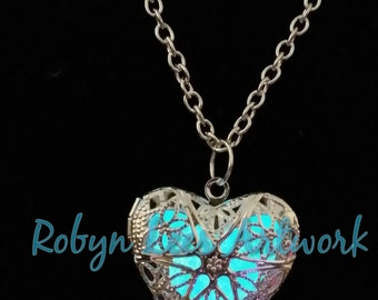Aqua Blue Glow In The Dark Filigree Heart Necklace in Silver and Bronze on Crossed Chain