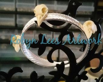 Trio of Resin Raven Crow Bird Skulls on Silver Feather Bangle Bracelet