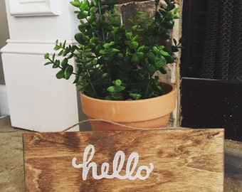 "Wood ""hello"" sign"