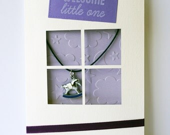 "Handmade Welcome Little One greeting card with purple ""rocking horse"" keepsake jewellery piece"