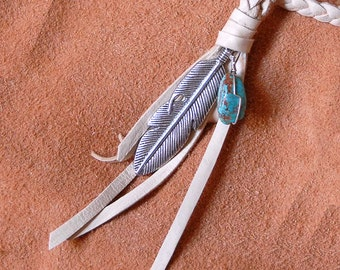 Braided light tan leather necklace with silver feather charm and turquoise bead accent.