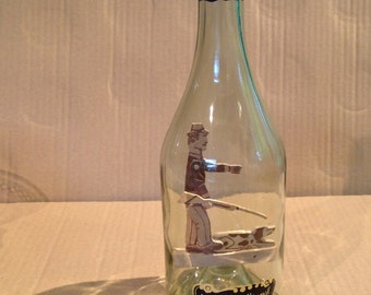 Bottle containing a hunter and his dog
