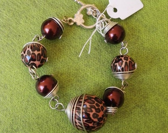 Hand made wire wrapped bracelet spotted black and brown beads adjustable size