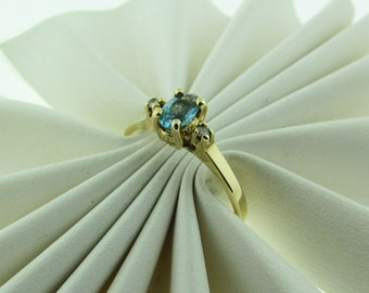 Vintage 10 K gold blue Topaz and diamond ring