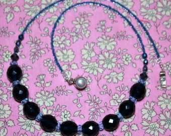 Indigo Swarovski round faceted crystal necklace with silver/pearl clasp.