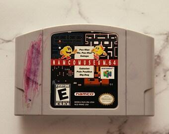 vintage 1990s NAMCO MUSEUM 64 videogame. NINTENDO 64. pac-man. ms pac-man. galaga. galaxian. pole position. dig-dug. gamer. kids. arcade.