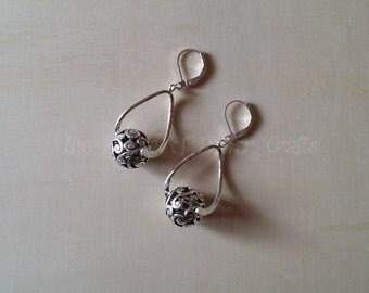 Handmade Earrings with Intricately Carved Metal Beads