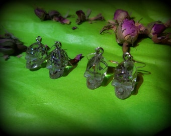 Skully Earrings - SUMMER CLEARANCE SALE!!! One of a kind resin skull earrings with real flower seeds. Every skull is a unique piece.