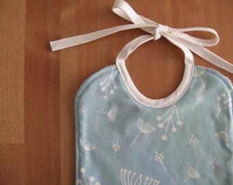 Organic cotton baby bib. Blue fabric.