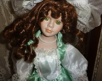 17 Inch Green Eyed Tilted Head Porcelain Doll