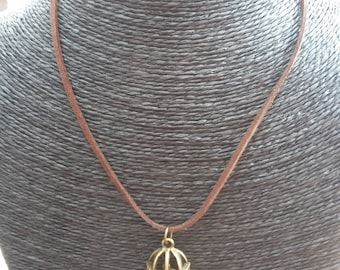 Antique brass tone caged bird / birdcage pendant necklace - on brown flat suede leather cord