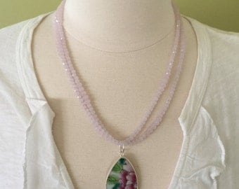 "Summer statement double strand of pink faceted glass beads with colorful porcelain floral design pendent, 22"" length."