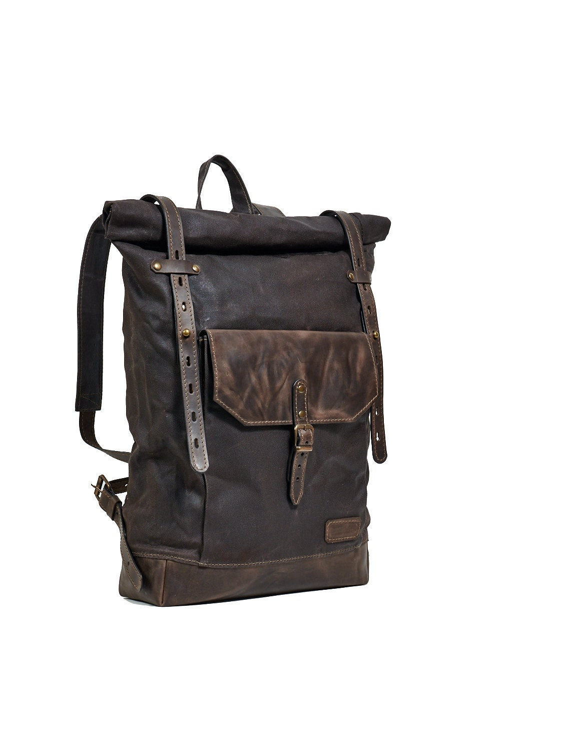 Dark brown waxed canvas backpack. Leather canvas backpack.