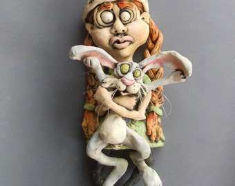 Little Girl Holding Rabbit Ceramic Wall Sculpture